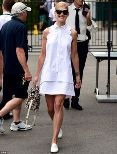 Perfectly pitched: Rosamund Pike looked every inch the English rose as she arrived at Wimb...