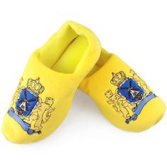 """What more unique night shoe than a clog slipper? Keep your feet cozy at night without """"klomping"""" around the house. These clog slippers featuring the Dutch Coat"""