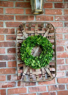 Boxwood Wreath hanging on Tobacco Basket from Whipperberry | Friday Favorites at www.andersonandgrant.com
