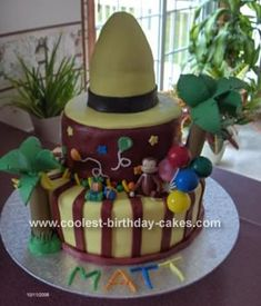 Curious George Cake: This Curious George cake is my 2nd fondant cake. My nephew wanted a Curious George cake for his 4th birthday. I have seen cakes made as the big yellow
