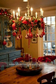 Christmas decoration - wreath around chandelier with ribbons and ornaments