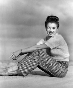 Womens 1940s Pants Styles  History and Buying Guide - A young Marilyn Monroe wearing houndstooth pants and loafers
