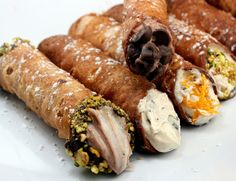 The cannoli is a typical dessert from Sicily, consisting of a mass rolled into a tube, which has the ingredients mixed with ricotta inside. Description from misadventureswithandi.com. I searched for this on bing.com/images