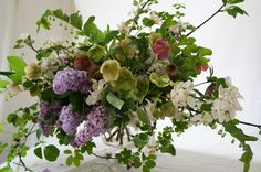 Spring arrangement with lilacs, hellebores, solomon's seal, lily of the valley Grace Kim Floral & Event Design www.gracekimflowers.com