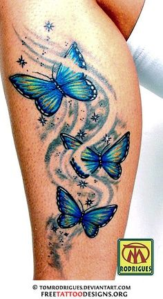Tribal blue color butterfly tattoo on leg...modify less butterflies...in purple for Fibromyalgia, add words...on foot!