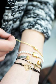 stretchy bracelets. Gold, pearl, black.