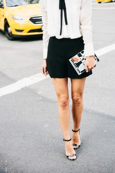 shorts and heels cross the street.