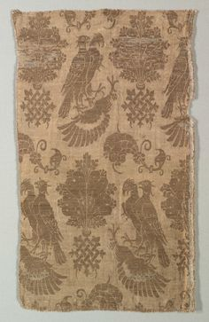 Gold-patterned Silk with Falcons and Heraldry | Cleveland Museum of Art