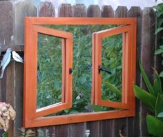 Garden Mirror - Create the illusion of more space in a small yard