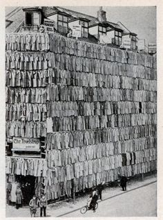 Overstocked with a large supply of men's spring and winter coats, a clothier in Copenhagen, Denmark, adopted a unique sales scheme. He erected a scaffolding around his store building and completely covered it from roof to sidewalk with more than a thousand overcoats. The novel display attracted prospective customers in such droves that police were summoned. Although the police ordered the proprietor to remove the display, he succeeded in selling all the overcoats. (date unknown)