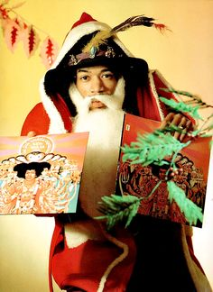 Jimi Hendrix as Santa Claus promoting his freshly released LP 'Axis: Bold As Love', Christmas, 1967.
