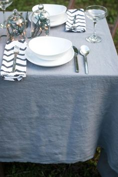 Inspire a magical outdoor meal with a softened linen tablecloth.