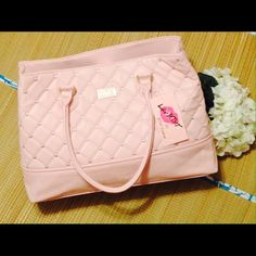 Chic Betsy Johnson Satchel Ooh la la. This stylish full size Betsy Johnson satchel speaks to chic with a fun, stitched and quilted pattern and a feminine blush color. Features gold-tone hardware, vegan leather, a spacious interior, and double carrying handles. Brand new with tags. The perfect statement piece for spring! Shine bright.    No Trading   Bundling Available  Fast Shipping    Holds for over $50 for 24 hrs only  Top 10% Sharer & Seller   Posh Mentor Betsey Johnson Bags Satchels