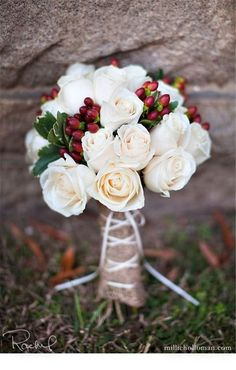 Winter wedding bouquet add silver and sparkly pine cones