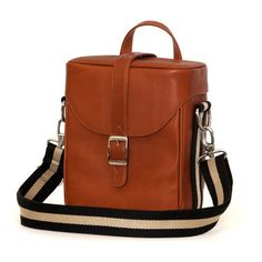 There's room for a full DSLR set-up in this close-fitting bag that meets today's requirements for performance, protection and stylish appeal. The tan JACK Hudson Leather Camera Bag from Jill-E Designs