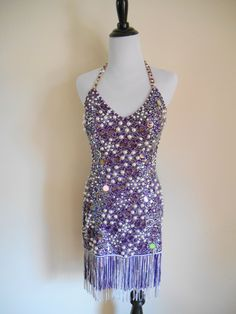 Beautiful purple Latin/Rhythm dress by Fiore Ballroom Designs. Covered in  Swarovski stones and pearls with fringe skirt accents.
