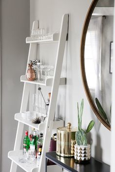 We're organizing every nook and cranny of our homes to start the new year off right and we love how Lisa Diederich got creative and used her bookshelf to display all of her bar accessories!
