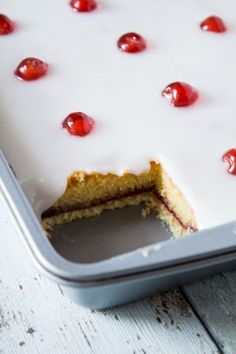 Iced Bakewell Tart Tray Bake complete with a cherry on top. Perfect for afternoon tea.