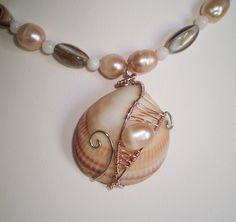 Wire-wrapped Seashell and Freshwater Pearl Necklace via Etsy