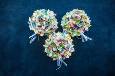 These bouquets are made out of Disney Maps!!!!!!  AMAZING Photography by LGBTQ friendly photographer Krystal Zaskey Photography. www.krystalzaskeyphotography.com  Palm Beach Zoo outdoor Disney-themed wedding | Equally Wed