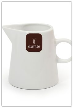 Aurile Milk Jug £7.99. Simple decorated with the stylish Aurile logo. Perfect for those, who realise that Aurile is not only delicious coffee but also a unique lifestyle. It is designed for presentations and tastings, it is useful not only at home and at work, but also in bars and cafés. - smooth porcelain - individually selected elements - hand applied motif - dishwasher safe - capacity: 150 ml