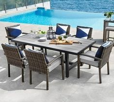 GLUCKSTEINHOME Newport 7pc all-weather wicker dining set from Home Outfitters $1,799.99 (25% Off) -