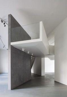 modern minimal mezzanine walkway with glass end wall.