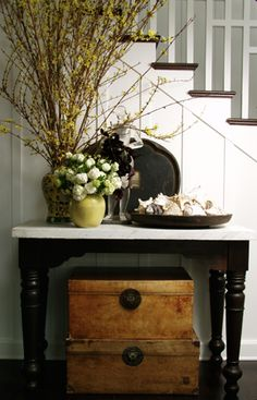 black, white, wood, and natural elements in vase.  I like the black tray leaned against the wall