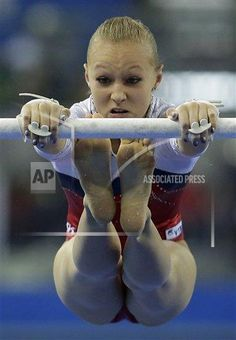 Russia's Daria Spiridonova performs during the women's uneven bars final of the Artistic Gymnastics World Championship at the Guangxi Gymnasium in Nanning, capital of southwest China's Guangxi Zhuang Autonomous Region Saturday, Oct. 11, 2014. (AP Photo/Andy Wong)