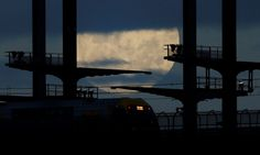 A commuter train en route to the suburb of Hornsby crosses on the Sydney Harbor Bridge under the supermoon. ─Reuters