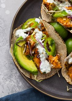 Spicy and crispy baked cauliflower tacos topped with a creamy cilantro sauce make a delicious and nutritious lunch or dinner in under 30 minutes! Cauliflower is Spicy Roasted Cauliflower, Cauliflower Tacos, Cooking Cauliflower, Roasted Garlic, Sin Gluten, Gluten Free, Cilantro Lime Sauce, Cooking Recipes, Healthy Recipes