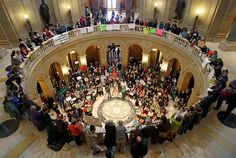 An overflow crowd gathered in the state Capitol Rotunda for a rally.