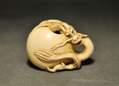 Dragon coming out from Mokugyo ivory netsuke
