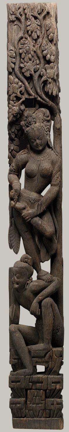 Temple strut with a devata standing on a hermit sage, 13th century  Nepal    Wood