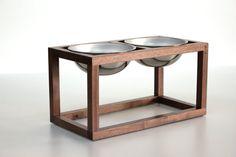 handmade, black walnut dog bowl holder. Minimal, open design elevates the dish to a comfortable