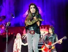 ...Alice Cooper did his own music and then he had a four song set of covers of 'Pinball Wizard' as a tribute to Keith Moon 'Fire' as a tribute to Him Hendrix 'Suffragette City' as a tribute to David Bowie and he lip-sang 'Ace of Spades' as his bass player sang for Lemmy Kilometer.  For some reason it is always freaking awesome when huge bands cover massive songs! It turns a crowd into a mob of screaming fanatics!... - For an unrelated story on how to rock out in London try this link…