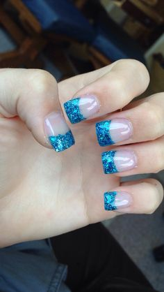 Blue sparkly French tip acrylic nails
