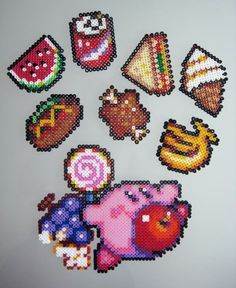 Kirby and loads of nom perler bead sprites by Lost Child