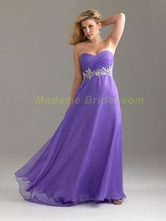 flowy puple prom dress.