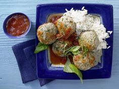 Summery basil flavors these mini veal meatballs, which are served with tomato sauce and rice.
