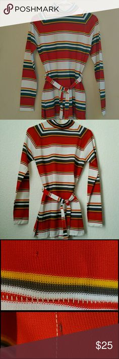"""Vtg. Striped Turtleneck Tunic Top This great 60s turtleneck has raglan sleeves, a matching tie belt, and center back zipper (replaced).  Has a teeny hole in the back of the sleeve about 1.5"""" above sleeve hem and a very small burn mark 1"""" away from side slit and 3"""" up from front side hem (not noticible unless looking for it and does not affect wear.) Wear with leggings, tights, skirt, or jeans. Poly knit, red blu, white, gold No tags or size. Measures:  18"""" pit to pit, 29"""" length from…"""