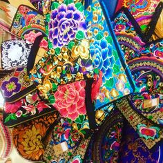 Embroidered wallets and clutches and cross body bags