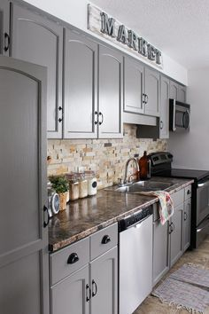 Before and after 25 budget friendly kitchen makeover ideas our kitchen cabinet makeover distressed kitchen cabinetsdiy solutioingenieria Gallery