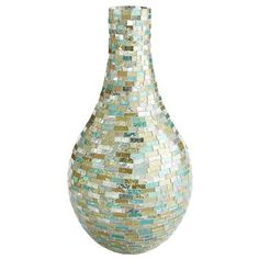 Take the textured look to a new level with our teardrop vase, handcrafted of beautiful light green glass. It's striking on its own and equally eye-catching when filled with beautiful botanicals.