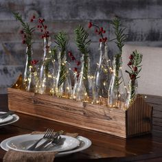 Combine twinkling lights and natural accents to Kirkland's Glass Bottle Vase Runner Set to create a magical centerpiece with festive hues and a warm glow. A set like this is sure to make your space feel just as inviting as it is beautiful!