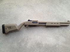 Remington 870 Tactical 12 gauge shotgun in FDE flat dark earth with new Magpul MOE furniture.