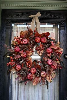feathers, berries, pine cones, and pomegranates...............oh my!