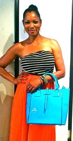 Garcelle Beauvais carrying the turquoise Georgina Tote