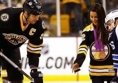 Olympic gold medalist Aly Raisman drops the puck for her team, the Boston Bruins.