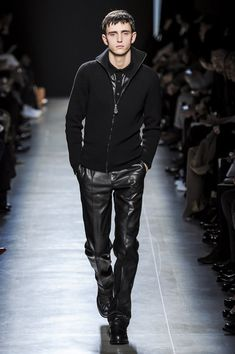 """FALL 2013 MENSWEAR  Bottega Veneta /    """"The clock is ticking,"""" said Tomas Maier after his show for Bottega Veneta this morning. """"We're in a fight with time. It's the one thing we can't control."""" Beating the clock was a staple of suspense in Hollywood's old film noirs, and there was a dark edge in Maier's new collection."""